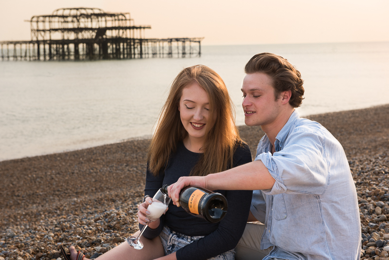 Brighton couple photography - bubbly on the beach